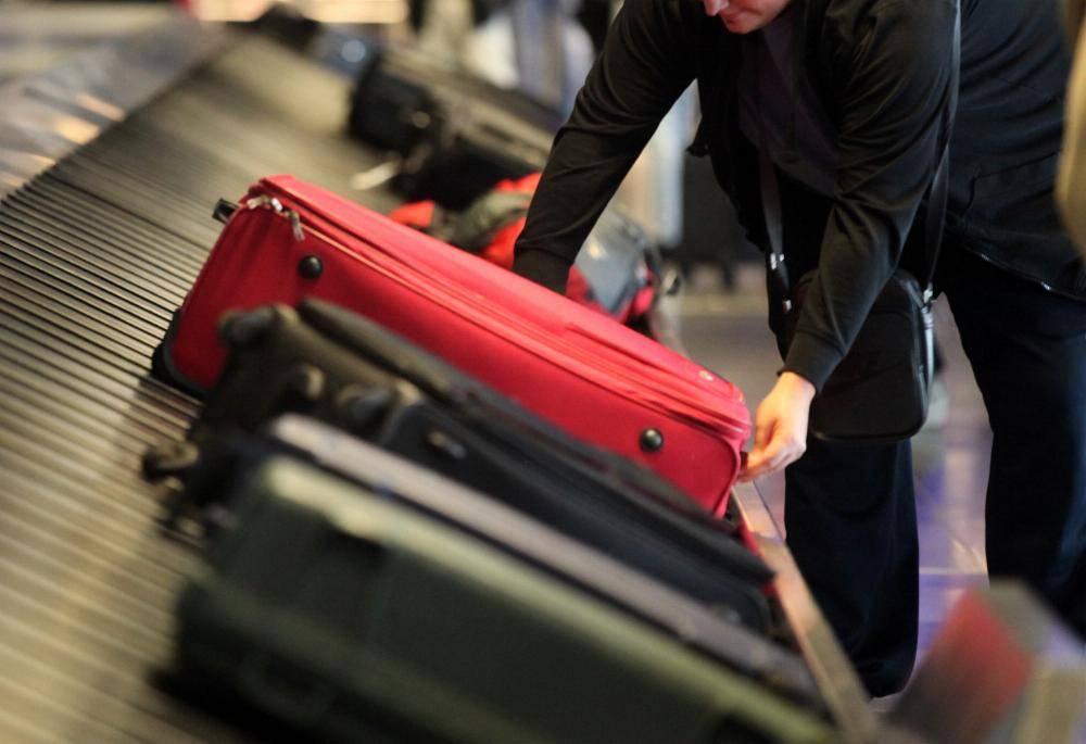 Reisende mit Koffer