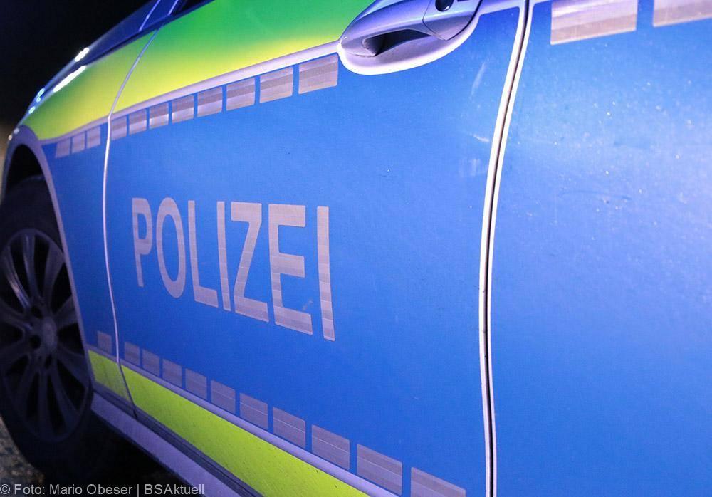 Polizeifahrzeug blau seitlich