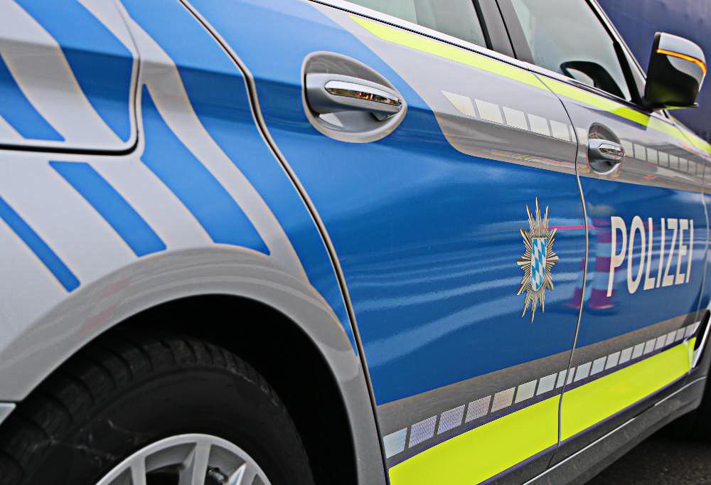 Polizeifahrzeug blau Wappen