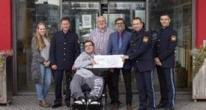 Scheckübergabe Polizei Augsburg Ulrichswerkstätten in Hochfeld
