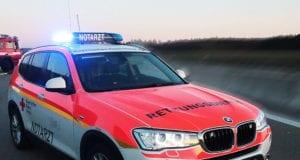 Notarztfahrzeug und Feuerwehrfahrzeug