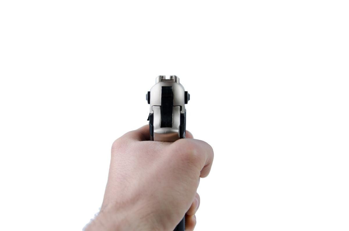 Pistole in der Hand Waffe